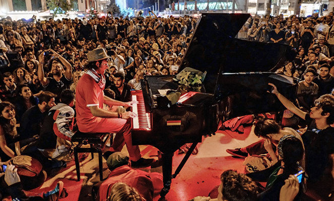 A man plays piano for the protesters in Taksim Square in Istanbul.