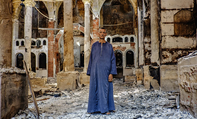 Inside a burned and destroyed Coptic Christina church in the Minya province.