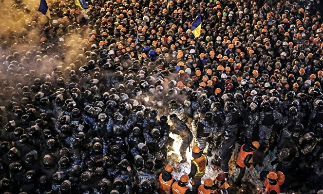 Berkut special foces and housing and utilities staff during a storm of the camp of the supporters of Ukraine's integration with the EU on Maidan Square in Kiev.