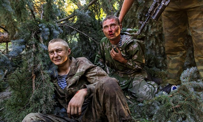 Wounded Ukrainian paratroopers taken captive during a combat operation in Shakhtyorsk.