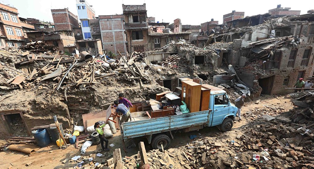 Nepalese earthquake survivors salvage their belongings from their damaged houses in devastated area of Bhaktapur, outskirts of Kathmandu, Nepal, 18 May 2015.