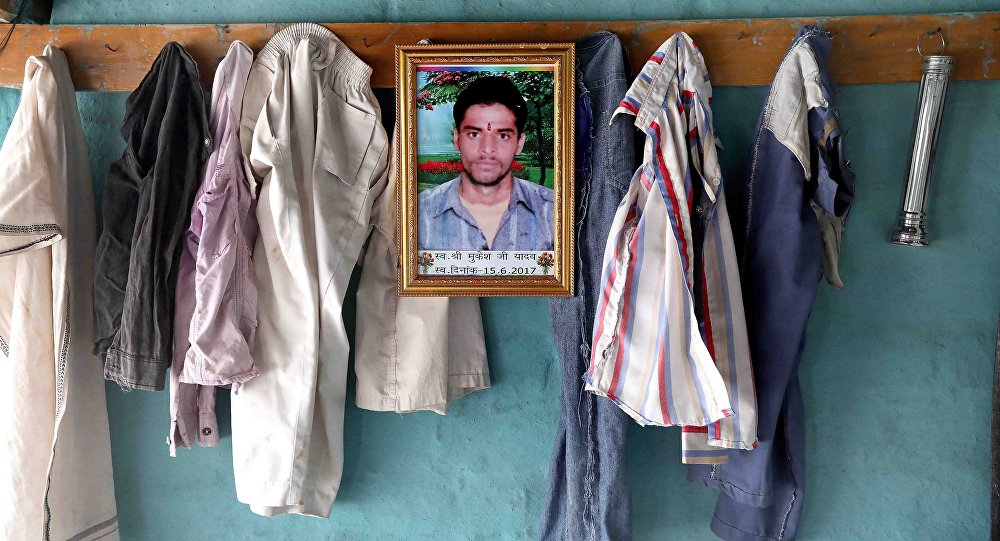 A photo of the 19 year old farmer Mukesh Yadav, who committed suicide by consuming pesticide, hangs on the wall of his residence in Lachur village in Sehore Madhya Pradesh, India, 19 May 2018
